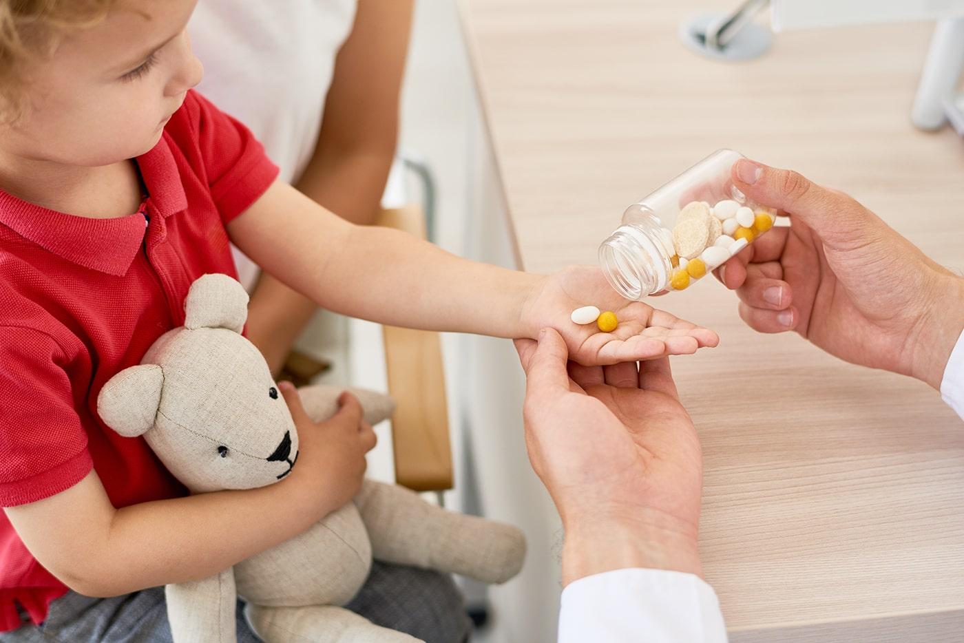 Child taking vitamins