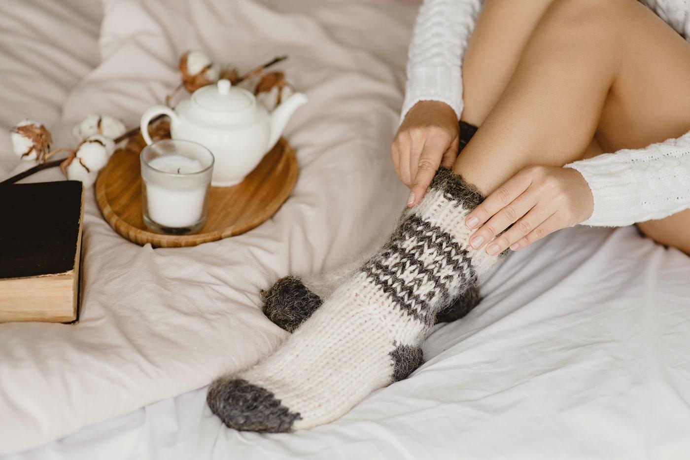 Woman putting on socks
